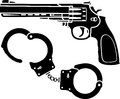 Handcuffs and pistol Royalty Free Stock Image