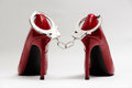 Handcuffs and sexy red high heels. bdsm Royalty Free Stock Photo
