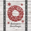 Handdrawing season s greetings christmas wreath on wooden board textrue background celebrate the holiday Royalty Free Stock Images