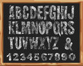 Handdrawn Font. Alphabet and Numbers with Grunge Lines and Strokes. Vector Scribble design. Isolated On School Desk Background