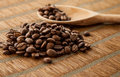 Handful coffee beans and coffee beans in a wooden spoon Fotografia Stock