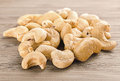 A handful of row cashew nuts on wood background images collected from four shots to increase the zone sharpness Stock Image