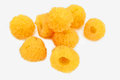 Handful of yellow raspberries a scattering a few berries ripe isolated on a white background Royalty Free Stock Images