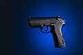 Handgun with blue and black background Royalty Free Stock Image