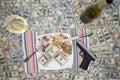 Handgun and champagne on 100 dollar bills Royalty Free Stock Photo