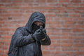Handgun man in mask with Stock Photography