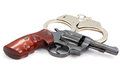 Handgun revolver and handcuff Royalty Free Stock Photo