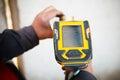 Handheld xrf analyzer spectrometer for scrap metal in action Stock Photos