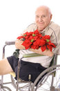 Handicap man in wheelchair with flowers Royalty Free Stock Image