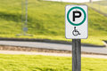 Handicap parking sign unusual with green circle instead of the standard blue includes handicapped wheelchair symbol Royalty Free Stock Photography