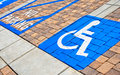 Handicap parking spot in a brick lot Royalty Free Stock Photography