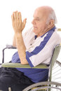 Handicap senior praying in wheelchair Stock Images