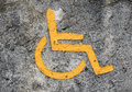 Handicap sign handmade old on concrete wall Stock Image