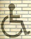 Handicap sign on the yellow brick wall Royalty Free Stock Photos