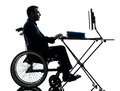 Handicapped business man computing laptop computer in wheelchai one silhouette studio on white background Stock Photo