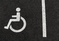 Handicapped disabled people parking lot sign for car wheel chair Royalty Free Stock Photo
