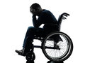 Handicapped man head in hands in wheelchair silhouette one studio on white background Royalty Free Stock Photo