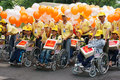 Handicapped people on wheelchair at community activity ho chi minh viet nam april group of invalid in a row with young volunteer Royalty Free Stock Photos
