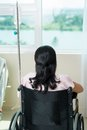 Handicapped rear view of a woman in the wheel chair Stock Image