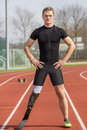 Handicapped sprinter standing track athlete with handicap stands on a race Royalty Free Stock Images