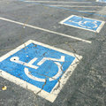 Handicapped symbols painted on parking spaces Stock Photo