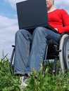 Handicapped woman with laptop Stock Image