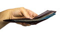 Handing holding a wallet of cash hand with the focus on the not the hand Royalty Free Stock Photo