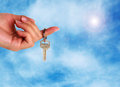 Handing over the keys on sky background Stock Photos