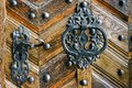 Handle and lock in iron on old wooden door Royalty Free Stock Photo