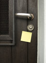Handle and post-it Royalty Free Stock Photography