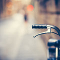 Handlebar of an Old Bike Resting in the Narow Street Royalty Free Stock Photo