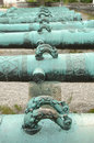 Handles on antique ornamented cannon barrels Royalty Free Stock Photo