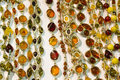 Handmade amber necklaces traditional accessories made of succinite on the shopboard prepared for sale Stock Image