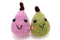 Handmade amigurumi crochet knit pink and green pears isolated on white background Stock Images