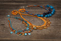 Handmade beaded jewelry necklaces on wooden table Royalty Free Stock Photo