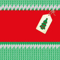Handmade card christmas illustration knitted fabric green red background label with a christmas tree Royalty Free Stock Photography