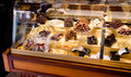Handmade chocolate display case in a European confectionery, selective focus