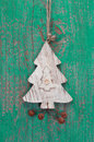 Handmade christmas decoration tree carved on a green background wooden Royalty Free Stock Image