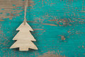 Handmade christmas tree for a wooden christmas background green or turquoise in country style Royalty Free Stock Image