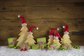 Handmade christmas trees carved and apple green christmas presen