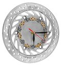 Handmade clock made of motorcycle parts. A clock face made of a