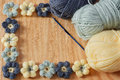 Handmade colorful crochet flower with skein on wooden table selective focus copy space Stock Image