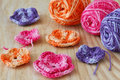 Handmade colorful crochet flowers with skein on wooden table selective focus Royalty Free Stock Photo