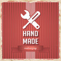 Handmade concept on red in flat design with icon of crossed screwdriver and wrench and slogan striped background vintage Stock Photo