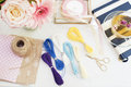 Handmade, craft concept. Materials for making string bracelets and handmade goods packaging - twine, ribbons. Feminine workplace c