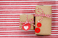 Handmade craft gift boxes on striped cloth Stock Photo
