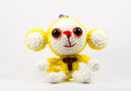 Handmade crochet monkey doll on white background yellow with t character Stock Photos