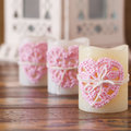 Handmade crochet pink heart for three candle for Saint Valentine Royalty Free Stock Photo