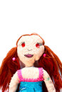 Handmade doll portrait of a with red hair on a white background Royalty Free Stock Images