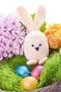 Handmade easter bunny with colorful flowers and easter eggs Royalty Free Stock Image
